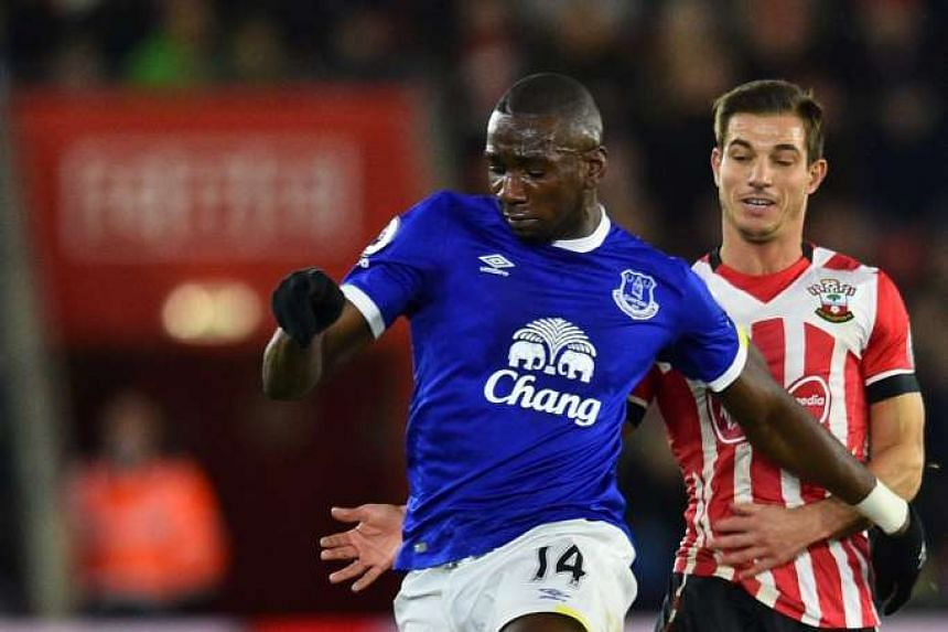 Everton's French-born Congolese midfielder Yannick Bolasie (left) vies with Southampton's German-born Portuguese defender Cedric Soares during the English Premier League football match at St Mary's Stadium in Southampton, southern England on Nov 27,
