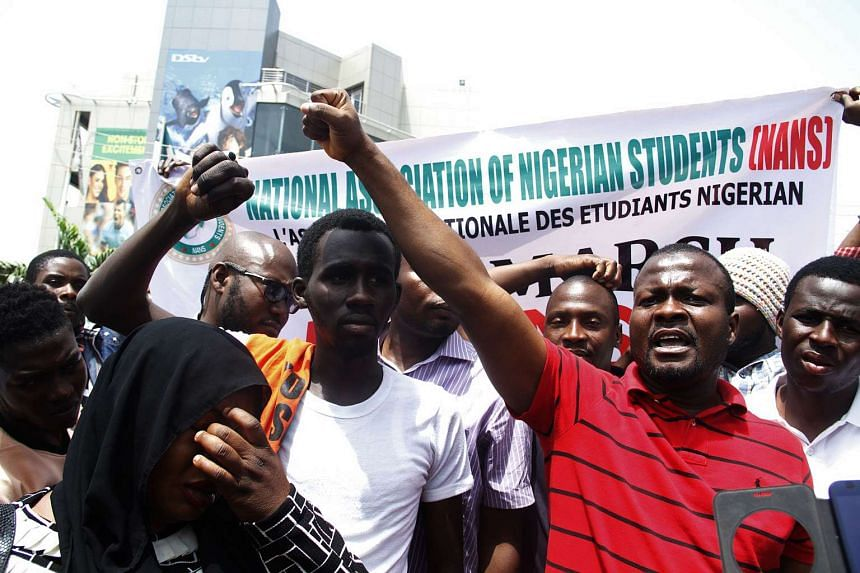Nigerian students shout slogans against South Africa as they protest outside the South African Digital Satellite TV's Nigerian headquarters in Abuja against the recent spike in attacks targeting foreign nationals in South Africa on Feb 23, 2017.