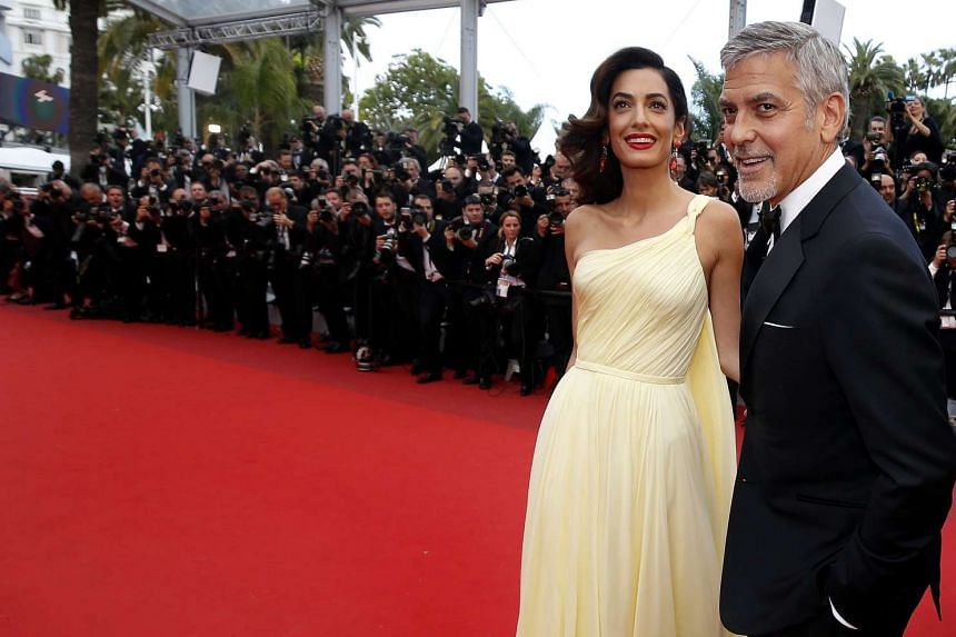 Clooney and wife Amal at  the Cannes Film Festival, in May, 2016.