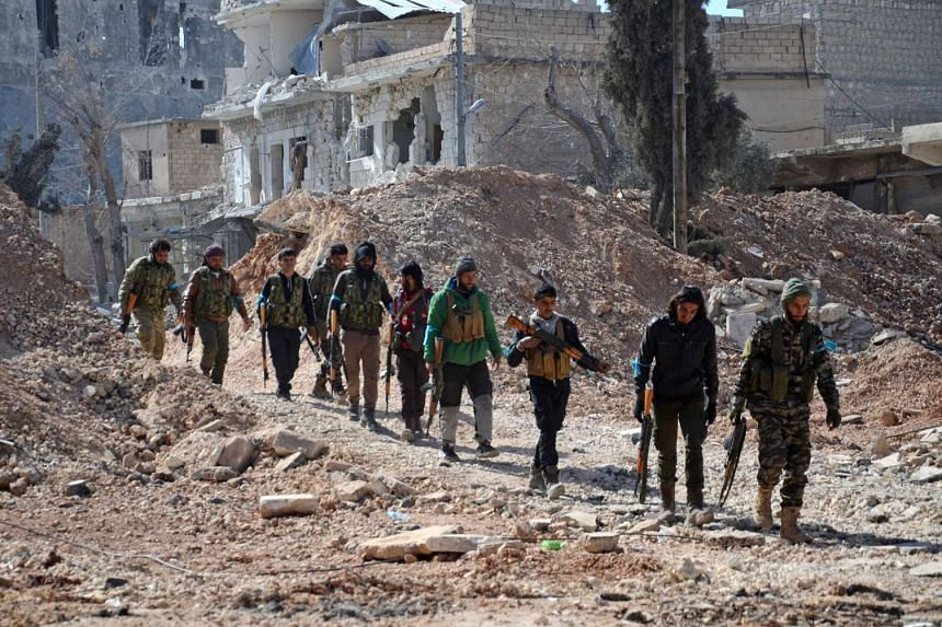 Rebel fighters, part of the Turkey-backed Euphrates Shield alliance, advance on Feb 20, 2017, towards the city of al-Bab.