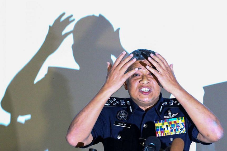 Malaysia's Royal Police Chief Khalid Abu Bakar demonstrating to the media during a news conference regarding the apparent assassination of Kim Jong Nam, at the Malaysian police headquarters in Kuala Lumpur, on Feb 22, 2017.