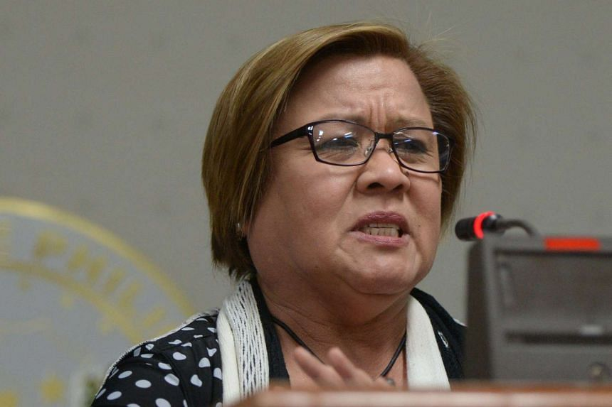 Philippine Senator Leila De Lima, a top critic of President Rodrigo Duterte, has been escorted from her office, after a court ordered her arrest on drug charges the day before.