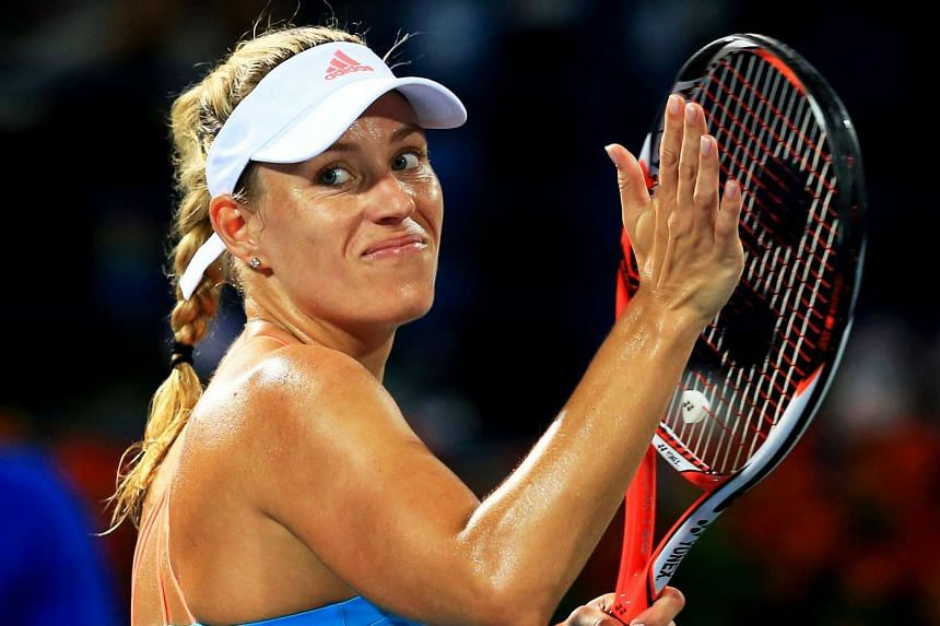 Angelique Kerber of Germany celebrates after defeating Ana Konjuh of Croatia.