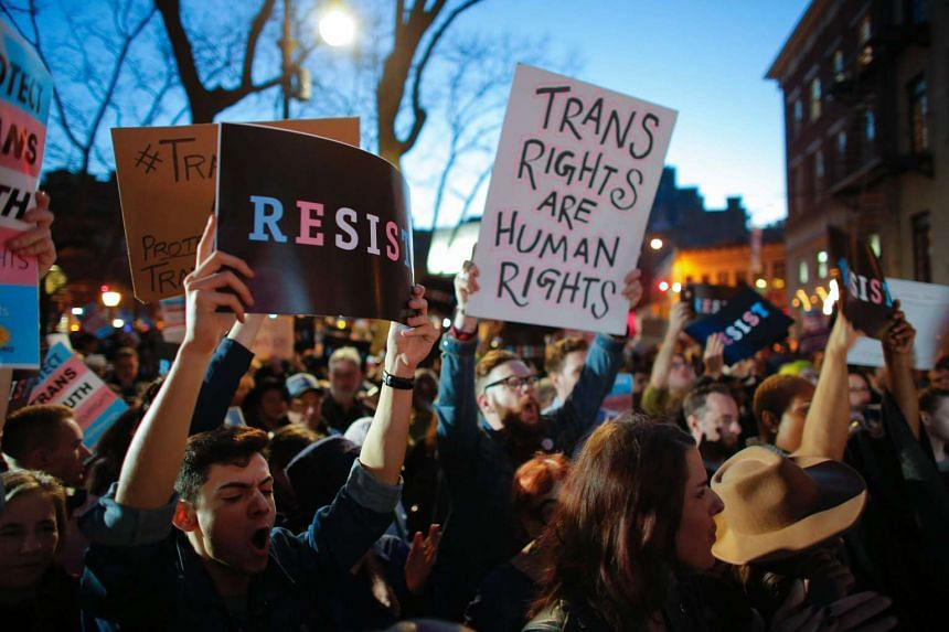People taking part in rally outside  the Stonewall Inn, a landmark of the gay rights movement, on Feb 23, 2017 in the Greenwich Village area of New York City.