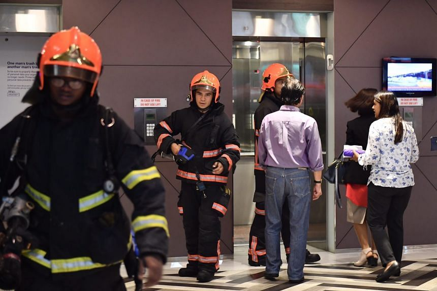 Firefighters at the scene on Friday (Feb 24) afternoon, after a fire broke out at Shenton House.