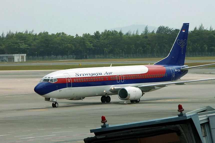 An Indonesia-registered Sriwijaya Air flight at Changi Airport in 2009.