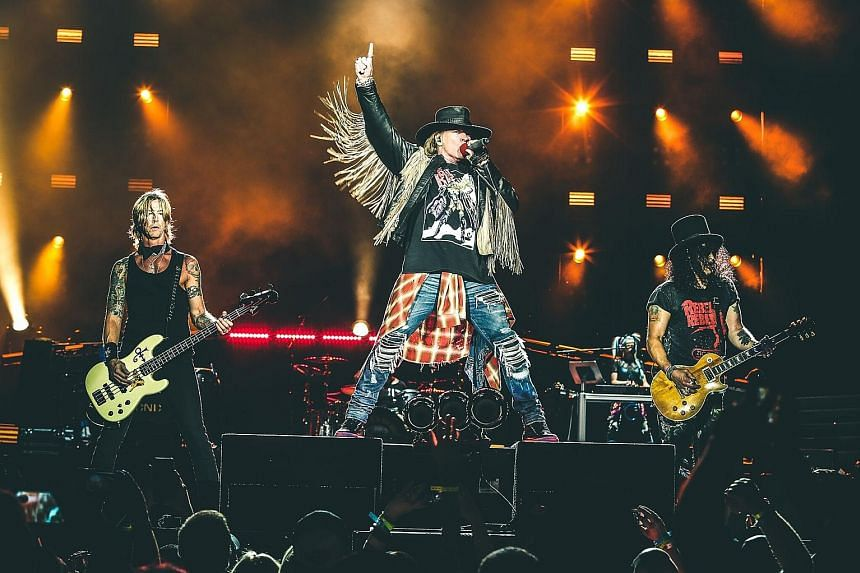 Guns N' Roses' (from left) bassist Duff McKagan, singer Axl Rose and guitarist Slash will be performing tomorrow at Changi Exhibition Centre.