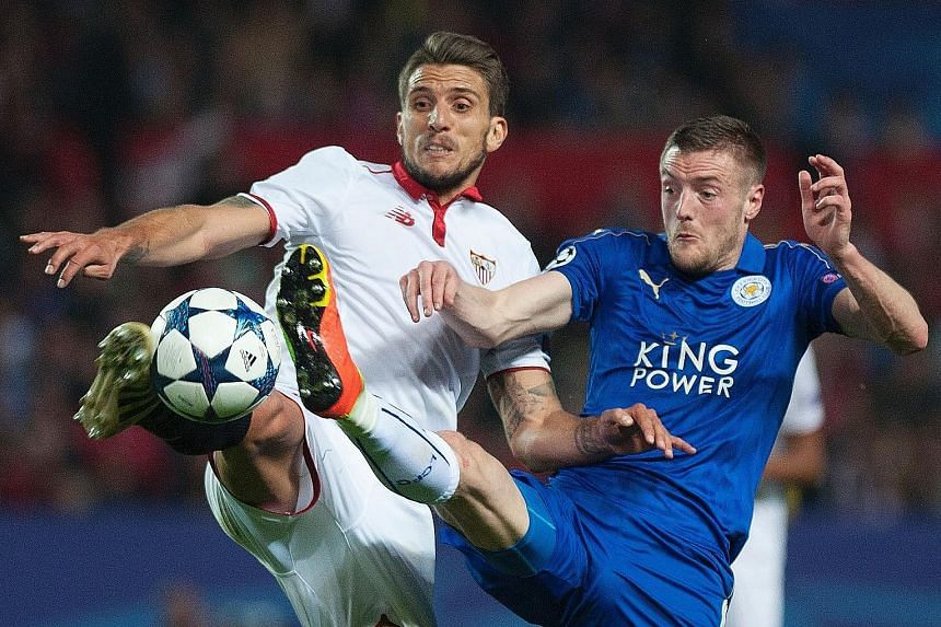 Sevilla's Daniel Carrico battling for the ball with Leicester's Jamie Vardy. Sevilla won 2-1, thanks to goals from Joaquin Correa and Pablo Sarabia but Vardy's away goal means the second leg on March 14 will be anyone's game.