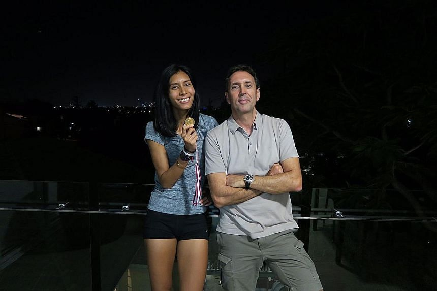 Hurdler Dipna Lim-Prasad posing with coach Luis Cunha after she met the qualifying mark for this year's SEA Games in Kuala Lumpur. She won the 400m hurdles gold in 1min 1.21sec at the Queensland Athletics Championships yesterday.