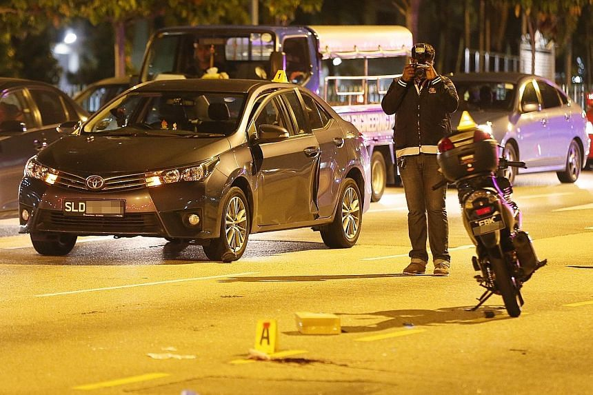 The scene of the accident along Ang Mo Kio Avenue 3 towards Ang Mo Kio Avenue 1. The passenger of the black Toyota was arrested.