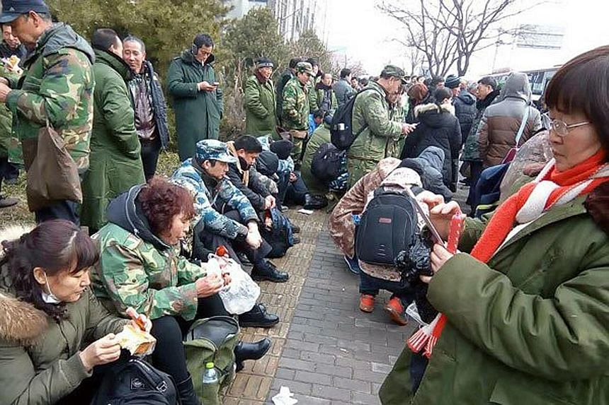 People's Liberation Army veterans gathering to protest outside the government disciplinary commission in Beijing on Wednesday. The rally is the largest within the city's limits since a rally last October.
