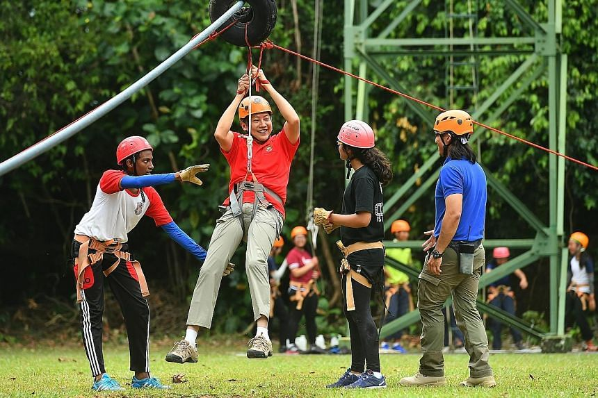 Mr Ng on the flying fox yesterday at the OBS' Pulau Ubin facility, where 350 students from two schools were at the camp.