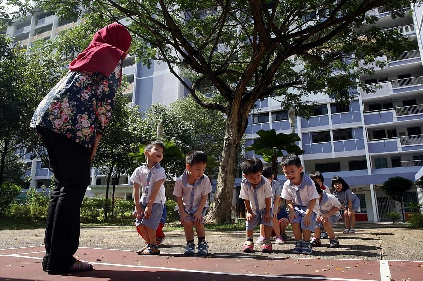 Teacher Salina Kasimon, 32, from PCF Sparkletots Preschool@Fengshan leading her nursery class in exercise. Full-day pre-school programmes will have to devote at least an hour to physical activity daily.