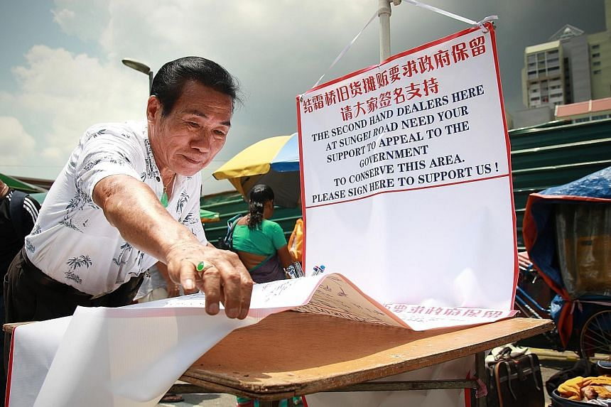 Mr Koh Ah Koon with banners seeking signatures to support the conservation of the Sungei Road flea market. His Association for the Recycling of Second Hand Goods represents about 70 vendors at the site.