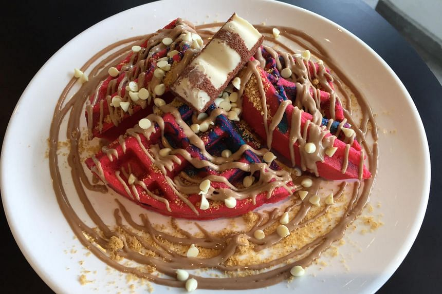 The Kinder Bueno waffle comes with generous swirls of hazelnut sauce.