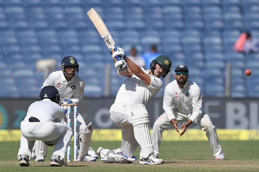 Australia's Mitchell Starc playing a shot as India's Ajinkya Rahane (left), Wriddhiman Saha (2nd left) and Murali Vijay (right) look on during the first day of the first Test cricket match between India and Australia, on Feb 23, 2017.