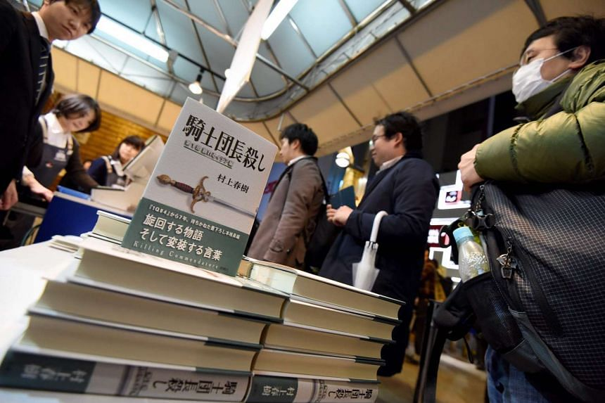 Copies of Killing Commendatore by Haruki Murakami, are displayed at a bookstore in Tokyo as the novel hit shelves in the early hours of Feb 24, 2017.