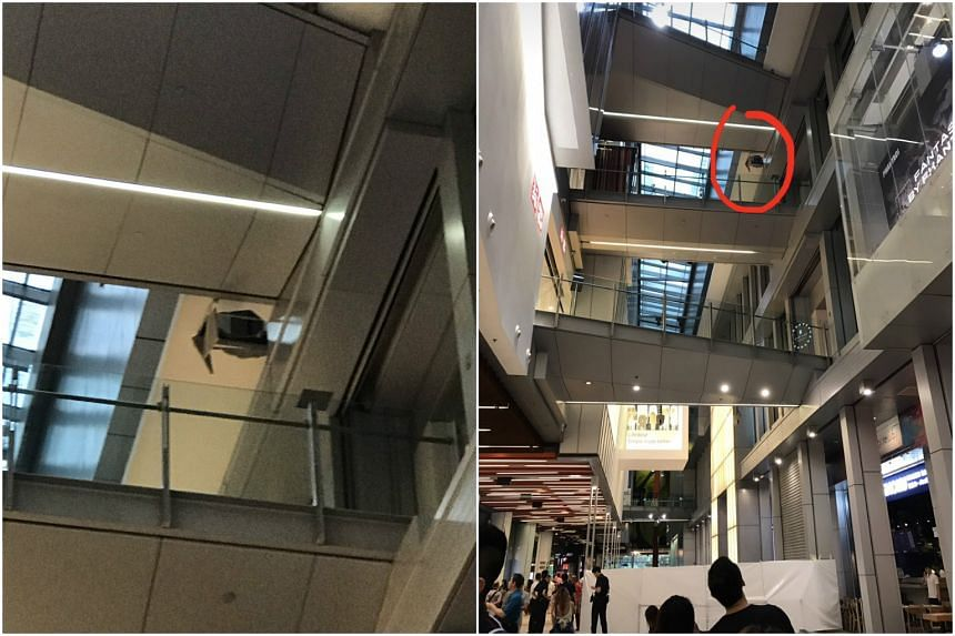 A hole is seen in the ledge beside the fourth-floor walkway linking Orchard Central and Orchard Gateway after a teen fell on Friday (Feb 24).