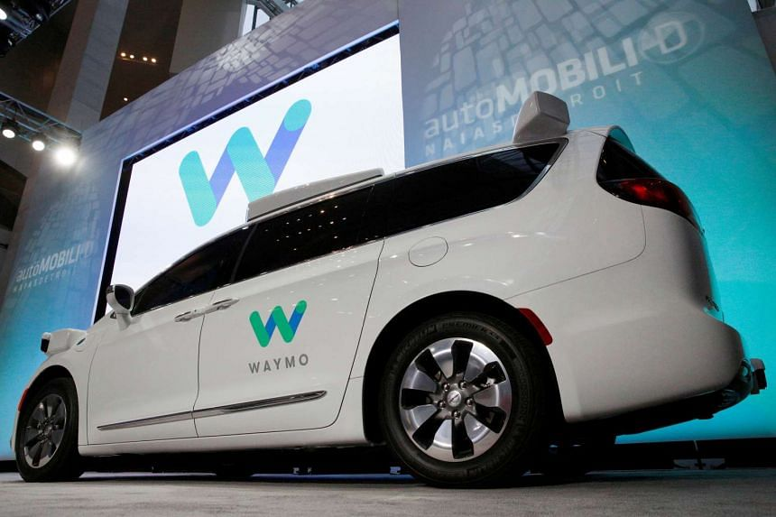 Waymo unveiling a self-driving Chrysler Pacifica minivan during the North American International Auto Show in Detroit, Michigan, on Jan 8, 2017.