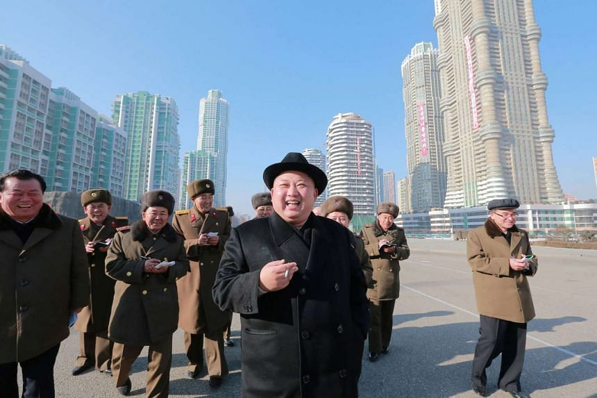 North Korean leader Kim Jong Un inspects a construction site.