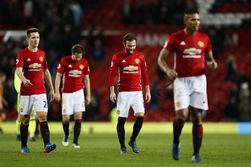 Manchester United's Juan Mata and Ander Herrera look dejected after a game.