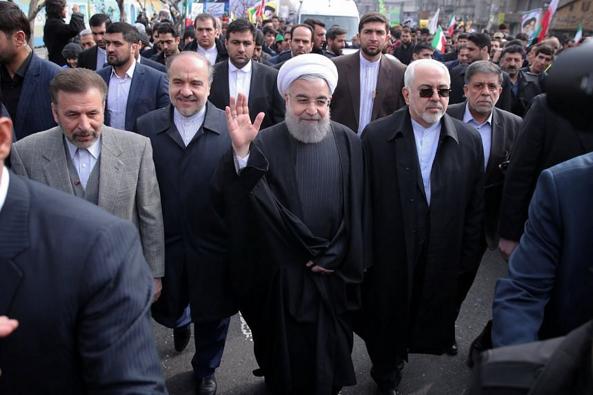 Iran's President Hassan Rouhani waves at an event marking the anniversary of Iran's 1979 Islamic Revolution, Feb 10, 2017.