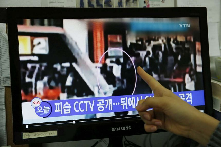 A South Korean watching a TV news report allegedly showing the assassination of North Korean leader Kim Jong Un's half-brother Kim Jong Nam at the airport of Kuala Lumpur, Malaysia.