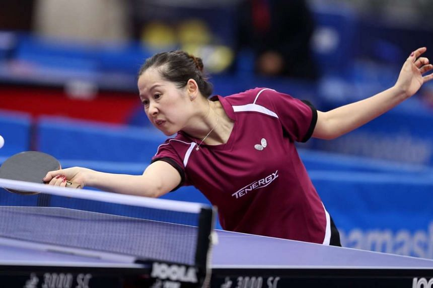 Dutch veteran table tennis player Li Jie in action at the International Table Tennis Federation Qatar Open, in a first round women's singles match against Japan's Hitomi Sato.