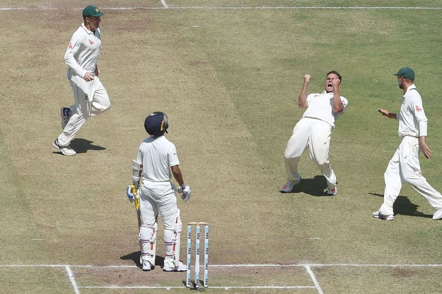Australia's Steve O'Keefe (centre) celebrating after the dismissal of India's Ajinkya Rahane during the second day of the first cricket Test match between India and Australia, on Feb 24, 2017.