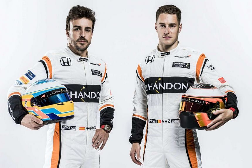 Spanish F1 driver Fernando Alonso (left) and Belgian driver Stoffel Vandoorne in a McLaren handout photo.