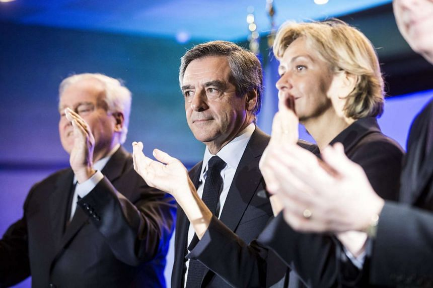Fillon (centre) arrives for a campaign rally in Paris, Feb 24, 2017.