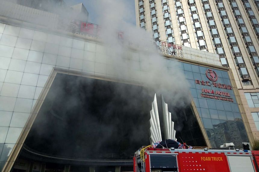 Smoke rises from a blaze at a hotel building in Nanchang, in central China's Jiangxi province, on Feb 25, 2017.
