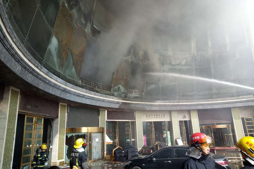 Firemen work to extinguish a fire at a hotel building in Nanchang, in central China's Jiangxi province, on Feb 25, 2017