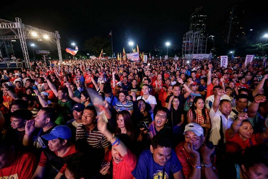 Supporters of Philippine President Rodrigo Duterte cheer during a gathering in support of the current administration in Manila, Philippines, on Feb 25, 2017.