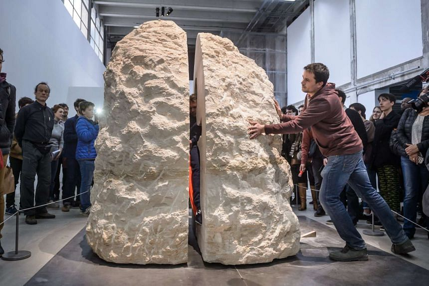 French artist Abraham Poincheval attempts  to live inside a rock for a week, as part of an art performance entitled 'Pierre' (Stone), at the Palais de Tokyo museum, in Paris, France on Feb 22, 2017.