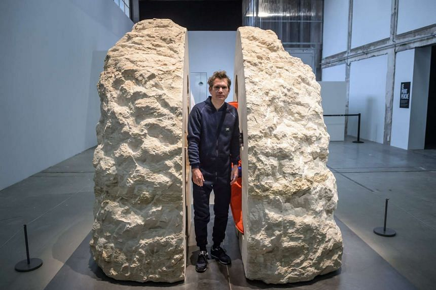 French artist Abraham Poincheval poses for photographs before attempting for the first time to live inside a rock for a week at the Palais de Tokyo museum, in Paris, France, on Feb 22, 2017.