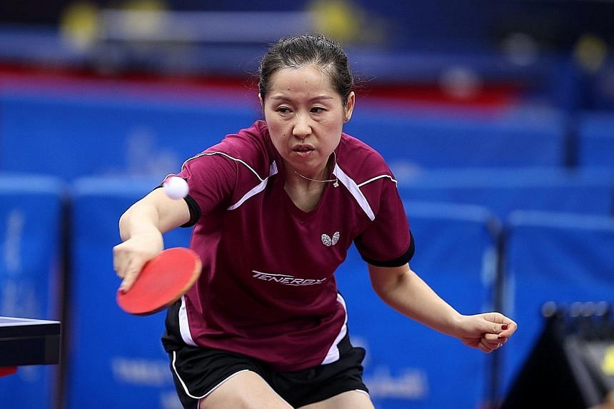 Dutch paddler Li Jie slicing a backhand return against Japan's Hitomi Sato at the ITTF Qatar Open.
