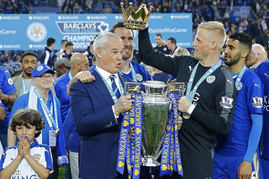Claudio Ranieri in happier times with goalkeeper Kasper Schmeichel and the Leicester players after they won the English Premier League title last season. The senior members of the squad later turned against the Italian, complaining of frequent and un