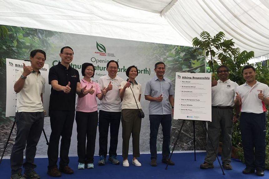 (From right to left) Host Senior Minister of State for Home Affairs and National Development Mr Desmond Lee launching the opening of Chestnut Nature Park (North) together with Chairman of Friends of Chestnut Nature Park Mr Siva, Minister Dr Vivian Ba