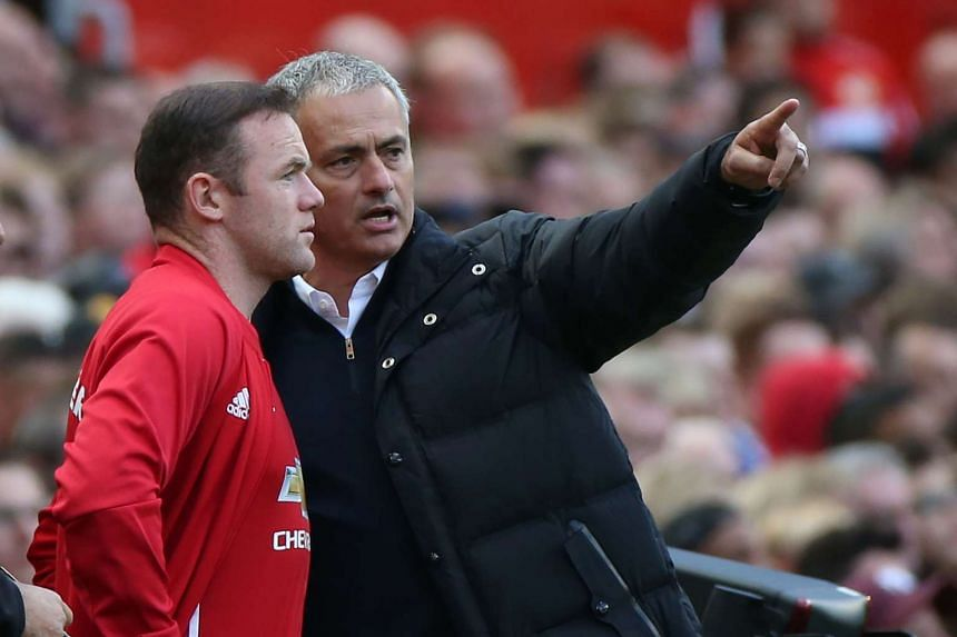 Wayne Rooney getting instructions from Jose Mourinho after coming off the bench. He may be a substitute again tomorrow.