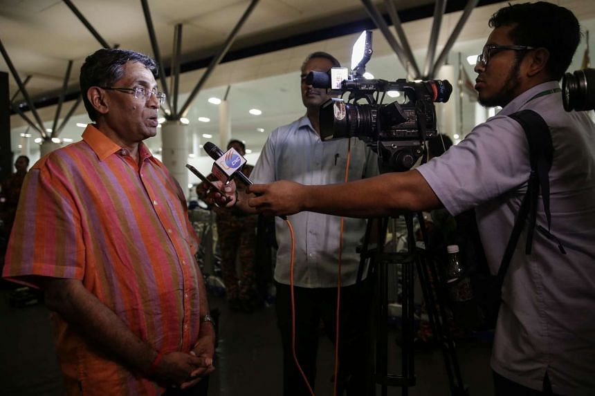 Malaysia Health Minister S. Subramaniam (left) speaks to the press outside Kuala Lumpur International Airport 2, on Feb 26, 2017.