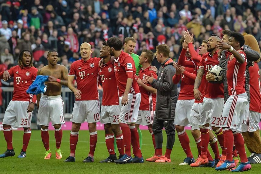 Players of Bayern Munich walk over the pitch after winning their German first division Bundesliga football match against Hamburger SV in Munich, on Feb 25, 2017.