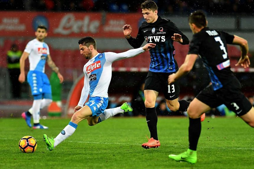 Napoli's forward Dries Mertens (left) kicks the ball during their Italian Serie A football match against Atalanta on Feb 25, 2017 at San Paolo stadium in Naples.