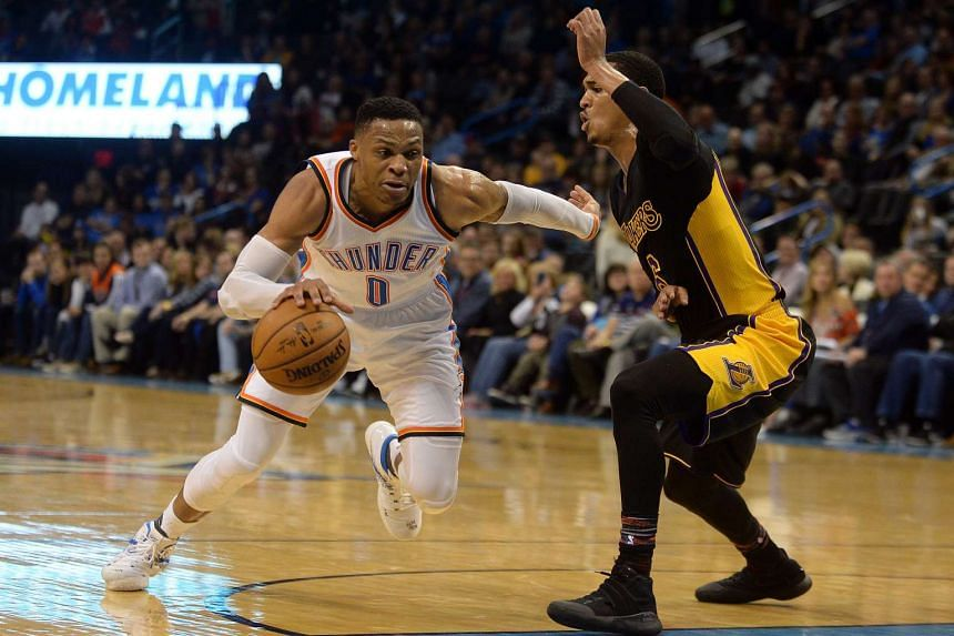 Oklahoma City Thunder guard Russell Westbrook (0) drives to the basket in front of Los Angeles Lakers guard Jordan Clarkson (6) during the fourth quarter.