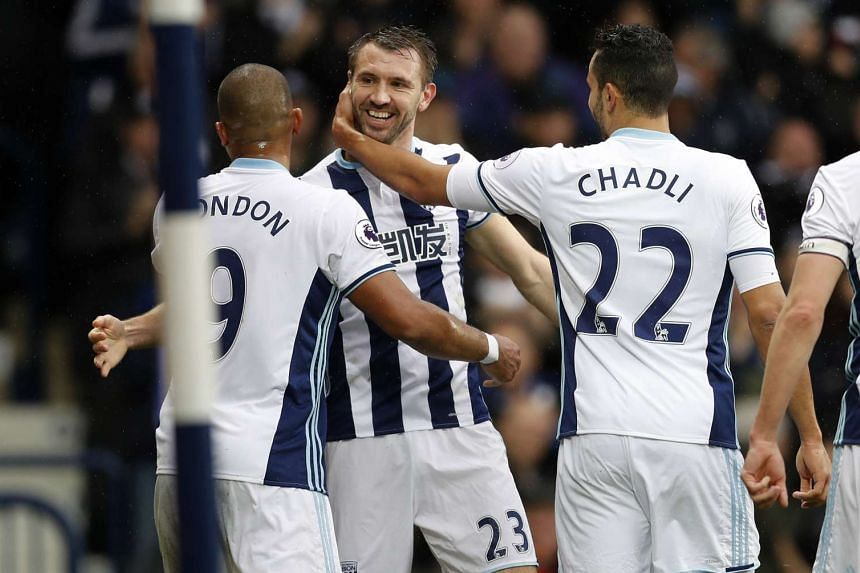 West Bromwich Albion's Gareth McAuley celebrates scoring their second goal with team mates.