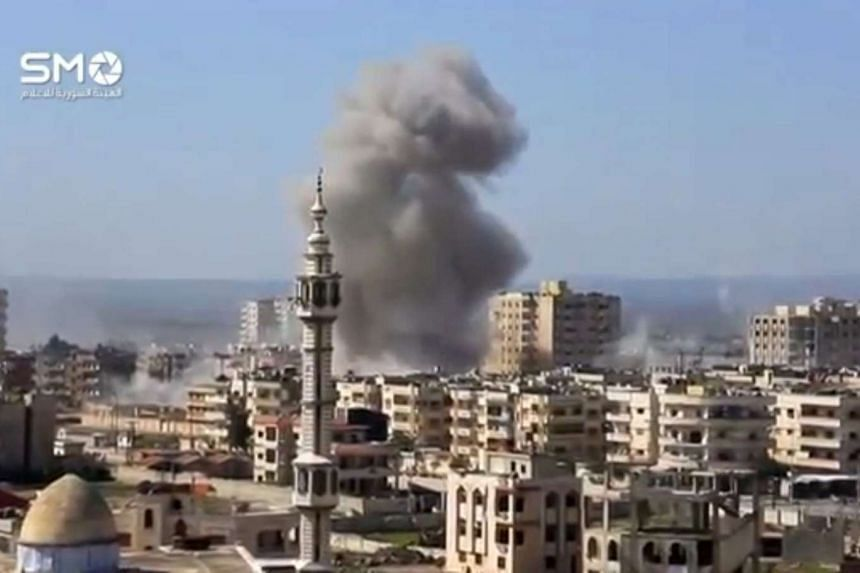A still image taken from a video uploaded to a social media website, on Feb 25, 2017, purports to show air strikes in the rebel-held al-Waer area of Homs, Syria.
