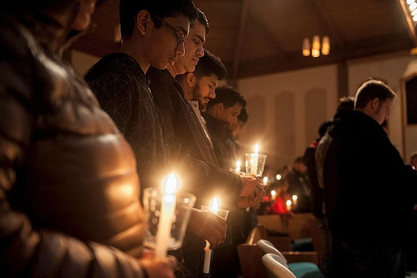"""A vigil being held for Mr Kuchibhotla (top left) at First Baptist Church in Olathe, Kansas, on Friday. Navy veteran Adam Purinton (left) reportedly opened fire while screaming at the victim and his friend Alok Madasani to """"get out of my country""""."""