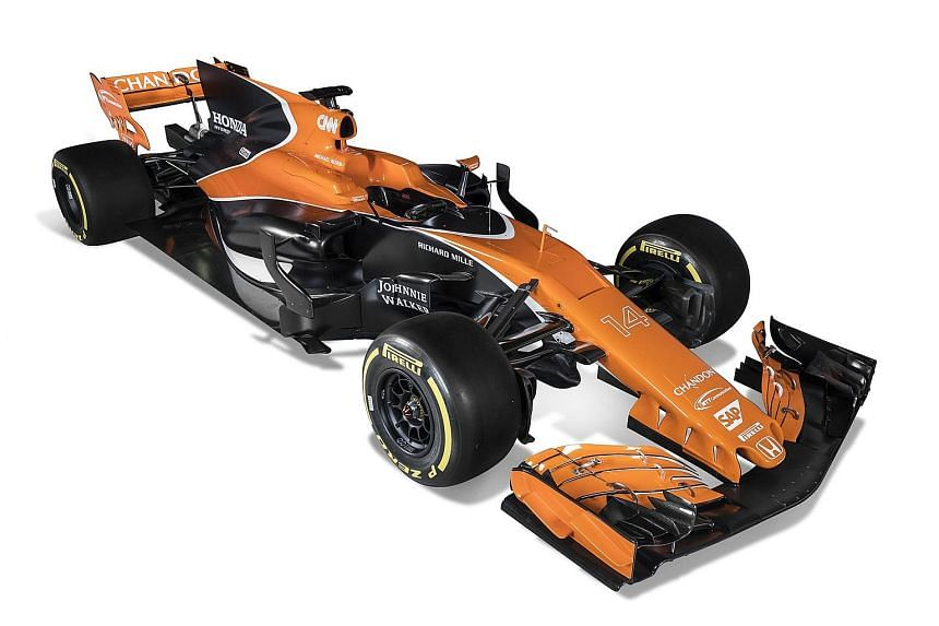 McLaren's new-look model has a longer nose and features a retro colour scheme of orange and black.