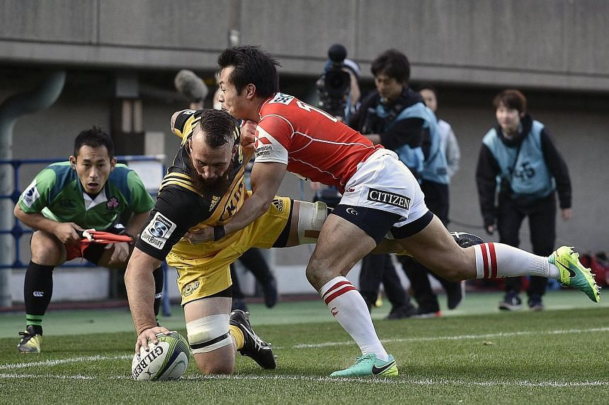 Blade Thomson touches down for a try for the Wellington Hurricanes. The champions ran in 13 tries in an overwhelming 83-17 victory, but the Sunwolves had 12 players making their debut in the match.