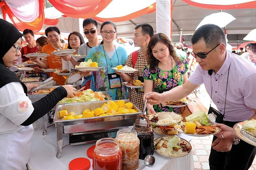 Visitors to Port Dickson at a buffet, under a programme aimed at Chinese tourists, in March last year.